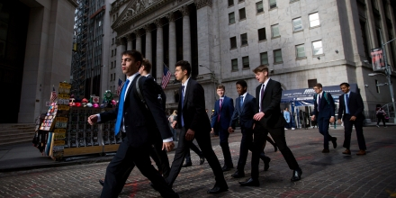 Pedestrians walk along Wall Street in front of the New York Stock Exchange (NYSE) in New York, U.S., on Monday, Oct. 23, 2017. U.S. stocks got off to a slow start as investors prepared for a big week of earnings reports, awaited possible changes at the Federal Reserve and monitored the progress of tax reform. Photographer: Michael Nagle/Bloomberg via Getty Images