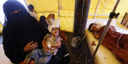 Yemeni children suspected of being infected with cholera receive treatment at a makeshift hospital in Sanaa on June 5, 2017.Yemen is descending into total collapse, its people facing war, famine and a deadly outbreak of cholera, as the world watches, the UN aid chief said. / AFP PHOTO (Photo credit should read /AFP/Getty Images)