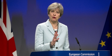 British Prime Minister Theresa May speaks during a media conference with European Commission President Jean-Claude Juncker at EU headquarters in Brussels on Friday, Dec. 8, 2017. British Prime Minister Theresa May, met with European Commission President Jean-Claude Juncker early Friday morning following crucial overnight talks on the issue of the Irish border.(AP Photo/Virginia Mayo)