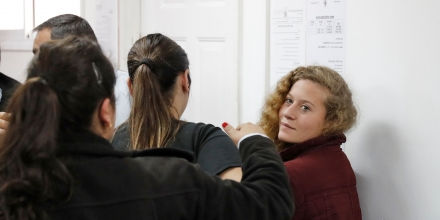Palestinian Ahed Tamimi (R), 17, a well-known campaigner against Israel's occupation, appears at a military court at the Israeli-run Ofer prison in the West Bank village of Betunia on December 20, 2017. Israel's army arrested Tamimi on December 19, 2017, after a video went viral of her slapping Israeli soldiers in the occupied West Bank as they remained impassive. / AFP PHOTO / Ahmad GHARABLI (Photo credit should read AHMAD GHARABLI/AFP/Getty Images)