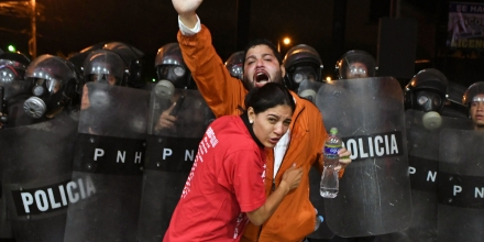 Supporters of Honduran presidential candidate for the Opposition Alliance against the Dictatorship party Salvador Nasralla, are affected by tear gas during a protest outside the Electoral Supreme Court (TSE), to demand the announcement of the election final results in Tegucigalpa, on November 30, 2017. Honduran opposition candidate Salvador Nasralla said he would not recognize the results to be announced by the Supreme Electoral Tribunal, after accusing it of tampering with the vote count to favor the reelection of President Juan Orlando Hernandez. / AFP PHOTO / ORLANDO SIERRA (Photo credit should read ORLANDO SIERRA/AFP/Getty Images)