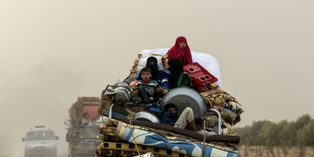 Displaced Syrians from Deir Ezzor head to refugee camps on the outskirts of Raqa on September 24, 2017 as Syrian fighters backed by US special forces are battling to clear the last remaining Islamic State group jihadists holed up in their crumbling stronghold. / AFP PHOTO / BULENT KILIC        (Photo credit should read BULENT KILIC/AFP/Getty Images)
