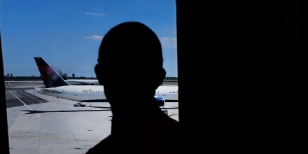 NEW YORK, NY - JUNE 26:  A man looks out at  planes at John F. Kennedy (JFK) international airport following an announcment by the Supreme Court that it will take President Donald Trump's travel ban case later in the year on June 26, 2017 in New York City. The court will let a limited version of the travel ban from six mostly muslim countries take effect before hearing full arguments in October.  (Photo by Spencer Platt/Getty Images)