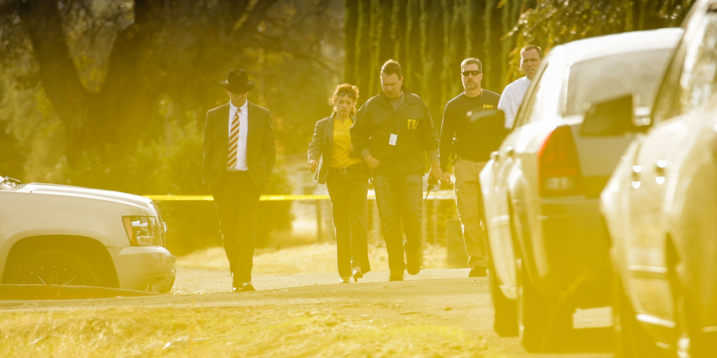 FBI agents are seen behind yellow crime scene tape outside Rancho Tehama Elementary School after a shooting in the morning on November 14, 2017, in Rancho Tehama, CaliforniaFour people were killed and nearly a dozen were wounded, including several children, when a gunman went on a rampage at multiple locations, including a school in rural northern California. / AFP PHOTO / Elijah Nouvelage (Photo credit should read ELIJAH NOUVELAGE/AFP/Getty Images)