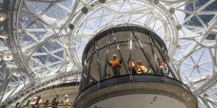 IMAGE DISTRIBUTED FOR AMAZON - Workers watch the ceremonial first planting in The Spheres at Amazon campus on Thursday, May 4, 2017, in Seattle. (Stephen Brashear/AP Images for Amazon)