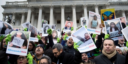 TOPSHOT - People protesting the cancellation of the Deferred Action for Childhood Arrivals rally on the steps to the Capitol Building on Capitol Hill December 6, 2017 in Washington, DC. / AFP PHOTO / Brendan Smialowski        (Photo credit should read BRENDAN SMIALOWSKI/AFP/Getty Images)