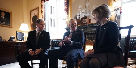 WASHINGTON DC- JANUARY 03 U.S. Senate Minority Leader Sen. Chuck Schumer  speaks to Sen. Doug Jones  and Sen. Tina Smith during a meeting at the U.S. Capitol