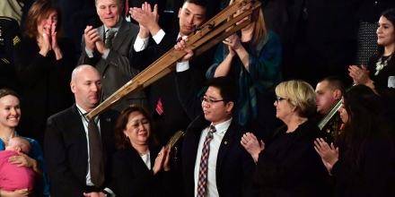 North Korean defector Ji Seong-ho raises his crutches as he is recognized by US President Donald Trump during the State of the Union address at the US Capitol in Washington, DC, on January 30, 2018. / AFP PHOTO / Nicholas Kamm        (Photo credit should read NICHOLAS KAMM/AFP/Getty Images)