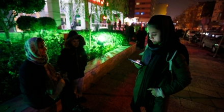 People phone and wait in the streets in Tehran overnight on December 21, 2017, after an earthquake was felt in the Iranian capital.The quake measuring 5.2 magnitude struck shortly before 11:30 pm (2000 GMT), according to the seismological centre of the University of Tehran. The epicentre of the tremor was located about 40 kilometres (25 miles) west of the capital. / AFP PHOTO / ATTA KENARE (Photo credit should read ATTA KENARE/AFP/Getty Images)