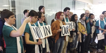 Demonstrators line up outside a meeting room protesting the New Orleans City Council vote rescinding a human rights resolution backed by Palestinian groups during a meeting in New Orleans, Thursday, Jan. 25, 2018. The Jan. 11 resolution encourages review of city investments or contracts involving businesses that violate human and civil rights. It mentions no nation, issue or business. But it's backed by a movement highly critical of Israel's policies toward the Palestinians. (AP Photo/Kevin McGill)