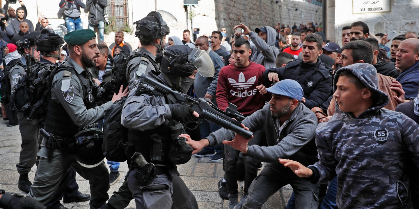 TOPSHOT - Israeli security forces and Palestinian protesters confront each other in Jerusalem's Old City on December 15, 2017. / AFP PHOTO / Thomas COEX (Photo credit should read THOMAS COEX/AFP/Getty Images)