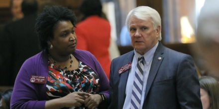 Rep. Stacey Abrams, D - Atlanta, and Rep. Jon Burns, R - Newington, confer in the floor of House Monday, March 6, 2017, in Atlanta. (Bob Andres/Atlanta Journal-Constitution via AP)