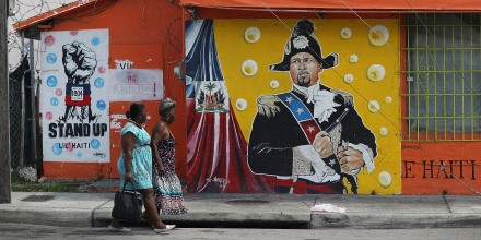 MIAMI, FL - MAY 17:  Women walk past a mural in the Little Haiti neighborhood on May 17, 2017 in Miami, Florida. People living in the neighborhood are concerned about the outcome of the decision on extending the Temporary Protected Status for Haitians living in the United States because it would possibly mean having friends and family of theirs being sent back to Haiti. 50,000 Haitians have been eligible for TPS and now the Trump administration has until May 23 to make a decision on extending TPS for Haitians. If it is allowed to expire on July 22, current TPS holders could possibly be deported.  (Photo by Joe Raedle/Getty Images)