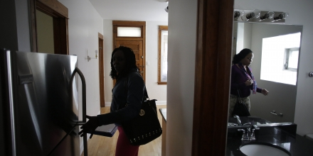 CHICAGO, IL - JUNE 27 :  Section 8 voucher holders Tracy Carrithers, left, and Carla Cathion view an apartment with Housing Choice Partners real estate specialist Jessie McDaniels (not pictured) in the Logan Square neighborhood of Chicago, Illinois June 27, 2015. Section 8 is a program for low-income families searching for quality housing that is overseen by the U.S. Department of Housing and Urban Development. Joshua Lott for the Washington Post