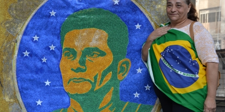 A woman stands next to an image of Brazilian judge Sergio Moro during a protest against suspended president Dilma Rousseff in Sao Paulo, on July 31, 2016.Protesters took to the streets of Brazil on Sunday to demand the final leaving of suspended President Dilma Rousseff or to defend her continuance, just five days before the start of the Rio 2016 Olympic Games. / AFP / NELSON ALMEIDA (Photo credit should read NELSON ALMEIDA/AFP/Getty Images)