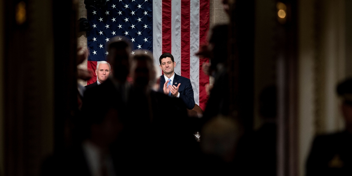 US Vice President Mike Pence (L) and Speaker of the House Paul Ryan (R-WI) wait as guests arrive for the State of the Union address on Capitol Hill January 30, 2018 in Washington, DC. / AFP PHOTO / Brendan Smialowski        (Photo credit should read BRENDAN SMIALOWSKI/AFP/Getty Images)