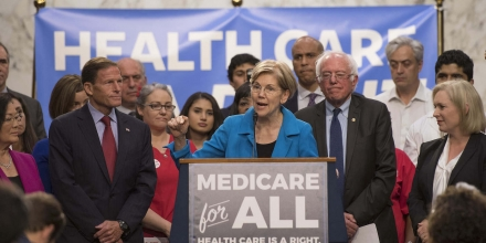 US Senator Elizabeth Warren (C), Democrat from Massachusetts, speaks with US Senator Bernie Sanders (2nd R), Independent from Vermont, as they discusses Medicare for All legislation on Capitol Hill in Washington, DC, on September 13, 2017. The former US presidential hopeful introduced a plan for government-sponsored universal health care, a notion long shunned in America that has newly gained traction among rising-star Democrats. / AFP PHOTO / JIM WATSON (Photo credit should read JIM WATSON/AFP/Getty Images)