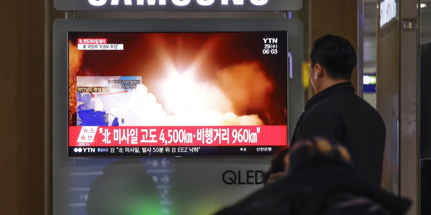 "Nov 29, 2017-Seoul, South Korea-People watches a TV screen showing a local news program reporting North Korea's missile launch at the Seoul Train Station in Seoul, South Korea, Wednesday, Nov. 29, 2017. North Korea abruptly ended a 10-week pause in its weapons testing by launching what the Pentagon said was an intercontinental ballistic missile, apparently its longest-range test yet, a move that will escalate already high tensions with Washington. The Korean letters read ""Fired ballistic missile."" (Photo by Seung-il Ryu/NurPhoto via Getty Images)"