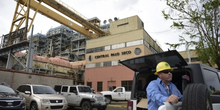 PREPA employee Jose Colon Maldonado waits for Governor Ricardo Rossello and staff from the army engineers corps to take a tour thru the facilities of the Palo Seco Thermal Power Plant, which the Electric Power Authority plans to activate in order to energize different areas of the metropolitan area, 28 days after the passage of hurricane Maria, in Catano, Puerto Rico, Wednesday, Oct. 18, 2017. A month after Hurricane Maria rolled across the center of Puerto Rico, power is still out for the vast majority of people as the work to restore hundreds of miles of transmission lines and thousands of miles of distribution lines grinds on. (AP Photo/Carlos Giusti)