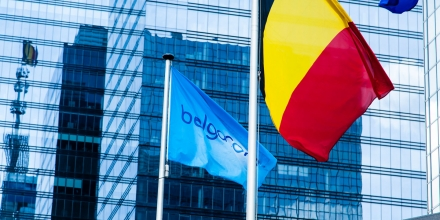 The Belgacom Group is the largest telecommunications company in Belgium, headquartered in Brussels.Belgacom flag, Belgian national flag hang together at the entrance mirrored in the windows. (Photo by Sander de Wilde/Corbis via Getty Images)