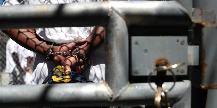 SAN QUENTIN, CA - AUGUST 15:  A condemned inmate stands with handcuffs on as he preapres to be released from the exercise yard back to his cell at San Quentin State Prison's death row on August 15, 2016 in San Quentin, California.  San Quentin State Prison opened in 1852 and is California's oldest penitentiary. The facility houses the state's only death row for men that currently has 700 condemned inmates.  (Photo by Justin Sullivan/Getty Images)