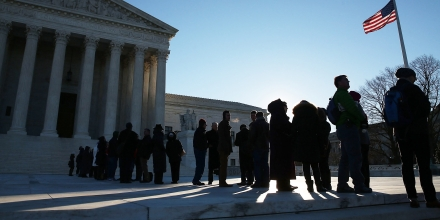 WASHINGTON, DC - JANUARY 11:  People wait in line to enter the US Supreme Court building January 11, 2016 in Washington, DC. The high court is hearing arguments inÊthe Friedrichs v. California Teachers Association case. The case will decide whether California and twenty two other states can make public-employees, such as public school teacher Rebecca Friedrichs, to pay union agency fees.  (Photo by Mark Wilson/Getty Images)