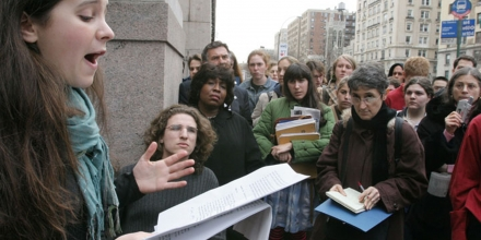 Bari Weiss, left, a sophmore at Columbia Univerity, speaks at a press conference organized by Columbians for Academic Freedom as a crowd listens outside the gates to Columbia University in New York Thursday March 31, 2005.  Weiss, and Columbia University senior Ariel Beery, second from left, co-founders of Columbians for Academic Freedom, held the press conference in response to the university report stating that Columbia University's Middle Eastern studies professors did not engage in large-scale intimidation of pro-Israel students.  (AP Photo/Tina Fineberg)