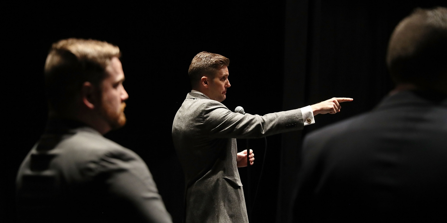 "GAINESVILLE, FL - OCTOBER 19:  White nationalist Richard Spencer, who popularized the term ""alt-right"" speaks during a press conference at the Curtis M. Phillips Center for the Performing Arts on October 19, 2017 in Gainesville, Florida. Spencer delivered a speech on the college campus, his first since he and others participated in the ""Unite the Right"" rally, which turned violent in Charlottesville, Virginia.  (Photo by Joe Raedle/Getty Images)"